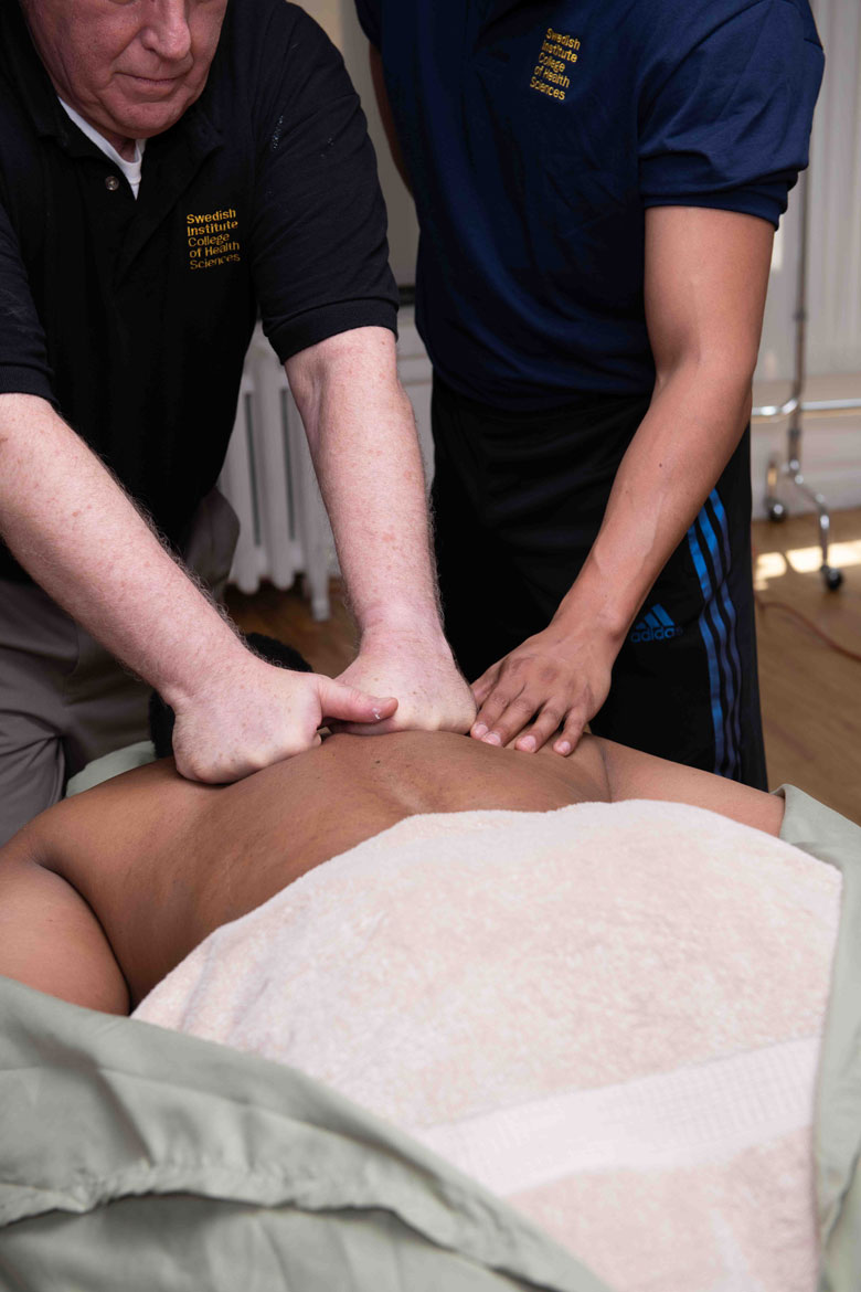 Swedish Institute Massage Therapy School Instructor practicing on patient - Swedish Institute - New York, NY